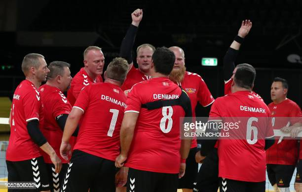 The Denmish team discuss strategy play against Canada during an exhibition sitting volleyball match at the Invictus Games 2018 in Sydney on October...