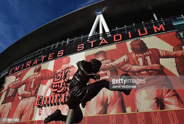 The Dennis Bergkamp statue is seen ahead of the Barclays Premier League match between Arsenal and Swansea City at Emirates Stadium on May 11 2015 in...