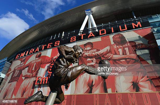 The Dennis Bergkamp statue is seen prior to the Barclays Premier League match between Arsenal and Burnley at Emirates Stadium on November 1 2014 in...