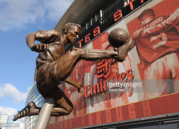 The Dennis Bergkamp statue is unveiled outside the stadium before the match between Arsenal and Sunderland in the Barclays Premier League at Emirates...