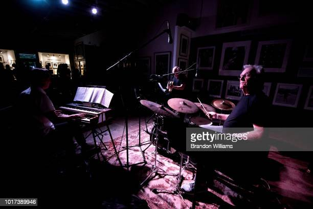Presenter Leroy Downs introduces The Denny Seiwell Trio Guitarist/composer John Chiodini drummer Denny Seiwell and organist Joe Bagg play at 'Just...