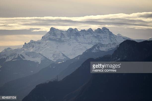The 'Dents du Midi' multisummited mountain is seen on November 20 2016 from the MontPelerin western Switzerland / AFP / FABRICE COFFRINI