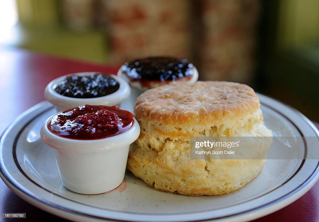 The Denver Biscuit Company, 3237 E. Colfax Ave., is busy preparing their biscuits for the day, including enough to go along in their Denver Biscuit Bus, which visits and sells biscuits at area farmer's markets. One item on the menu is the biscuit with a j : News Photo