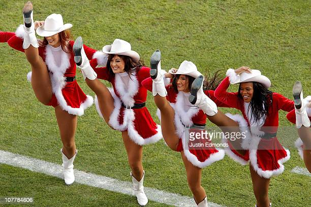 The Denver Broncos cheerleaders perform during a break in the action against the Houston Texans at INVESCO Field at Mile High on December 26 2010 in...