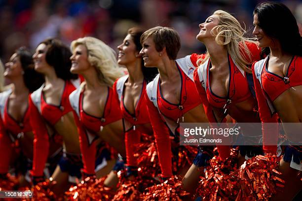 The Denver Broncos cheerleaders perform during a break in the action of a preseason game against the San Francisco 49ers at Sports Authority Field...