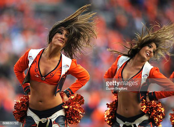 The Denver Broncos cheerleaders perform in the first half against the New England Patriots in the AFC Championship game at Sports Authority Field at...