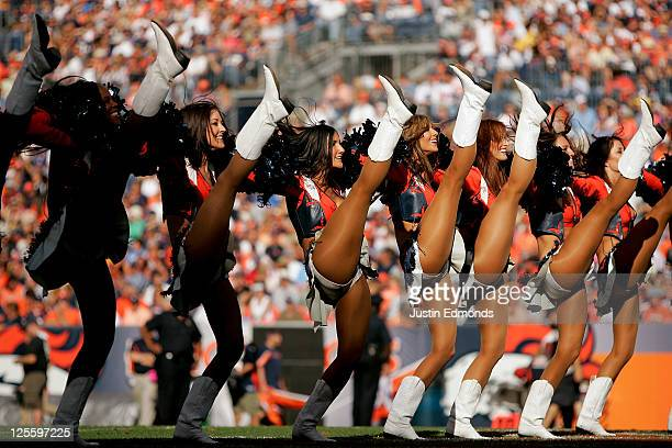 The Denver Broncos cheerleaders perform on the field prior to the start of the fourth quarter against the Cincinnati Bengals at Sports Authority...
