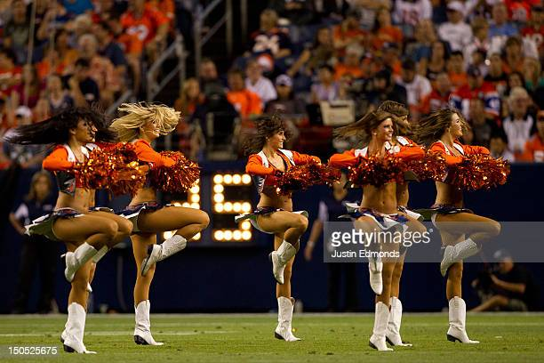 The Denver Broncos cheerleaders performs during a break in the action against the Seattle Seahawks at Sports Authority Field Field at Mile High on...