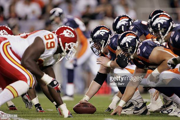The Denver Broncos face off with the Kansas City Chiefs during the NFL game at Invesco Field on September 12 2004 in Denver Colorado The Broncos won...