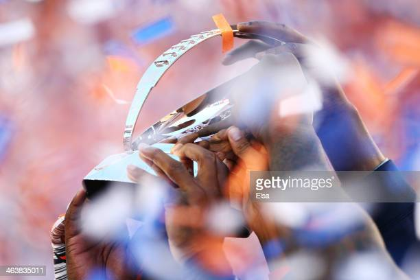 The Denver Broncos hold up the Lamar Hunt Trophy after defeating the New England Patriots 26 to 16 in the AFC Championship game at Sports Authority...