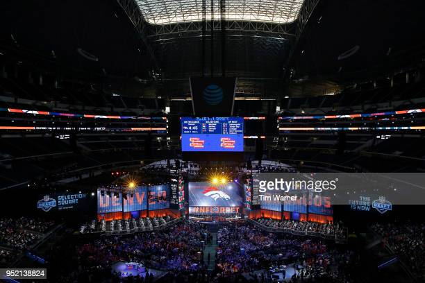 The Denver Broncos logo is seen on a video board during the first round of the 2018 NFL Draft at ATT Stadium on April 26 2018 in Arlington Texas