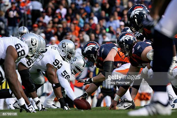 The Denver Broncos offense lines up on the line of scrimmage against the Oakland Raiders defense during week 12 NFL action at Invesco Field at Mile...