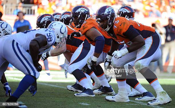 The Denver Broncos offensive line including tackle Russell Okung fires off the ball in the fourth quarter against the Indianapolis Colts at Sports...