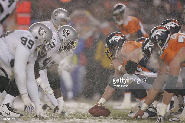 The Denver Broncos offensive line lines up against the Oakland Raiders defensive line during the game on November 28 2004 at Invesco Field at Mile...