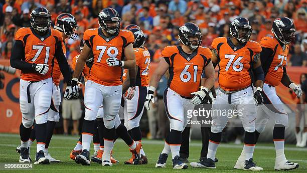 The Denver Broncos offensive line of Russell Okung Michael Schofield Matt Paradis Max Garcia and Donald Stephenson break the huddle during the...
