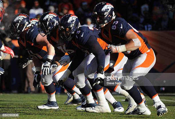 The Denver Broncos offensive line with Russell Okung at tackle fires off the ball in the first half against the New England Patriots at Sports...