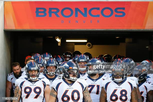 The Denver Broncos players wait to take the field prior to the start of the Hall of Fame Game between the Atlanta Falcons and the Denver Broncos...