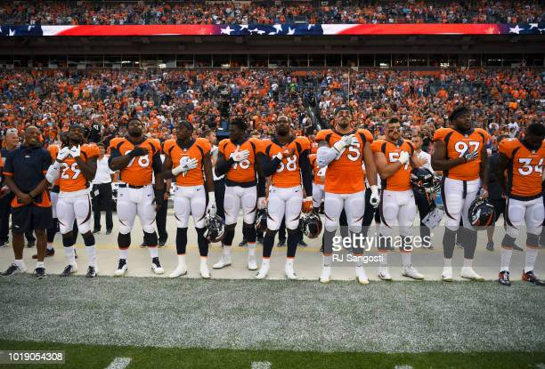The Denver Broncos stand for the colors before taking on the Chicago Bears during the second preseason game at Broncos Stadium at Mile High on August...