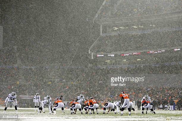 The Denver Broncos take on the Oakland Raiders in a snowstorm on November 28 2004 at Invesco Field at Mile High Stadium in Denver Colorado The...