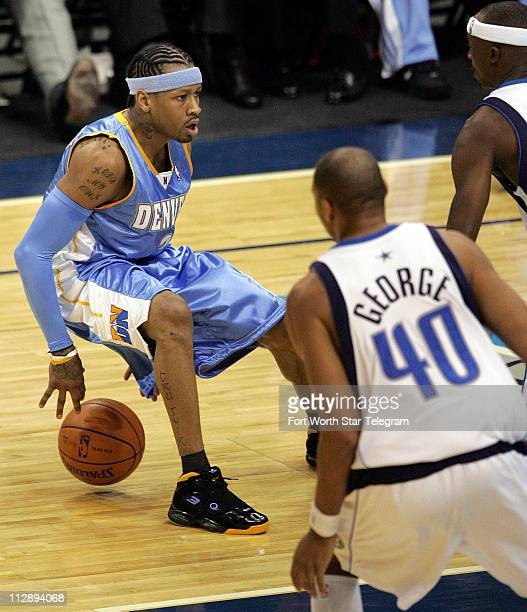 The Denver Nuggets' Allen Iverson dribbles behind his back during second quarter action against the Dallas Mavericks at the American Airlines Center...