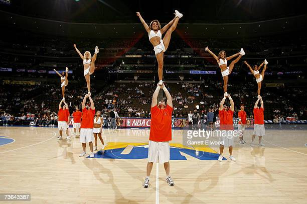 The Denver Nuggets Cheer Team entertains the crowd during the NBA game between the Houston Rockets and the Denver Nuggets at Pepsi Center on March 2...