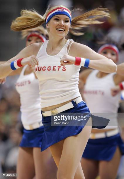 The Denver Nuggets cheerleaders dance in their retro outfits during a game against the Washington Wizards in the second half on March 22 2005 at the...