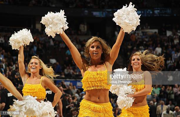 The Denver Nuggets Cheerleaders perform during a break in the action against the San Antonio Spurs at the Pepsi Center on March 23 2011 in Denver...