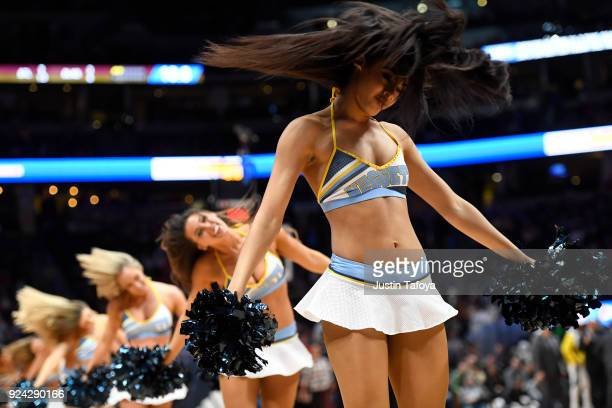 The Denver Nuggets' cheerleaders perform during a timeout between the Denver Nuggets and the Houston Rockets at Pepsi Center on February 25 2018 in...