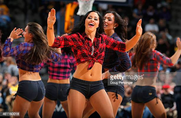 The Denver Nuggets Dancers perform clad in western wear as they recognize The National Western Stock Show during a break in the action against the...