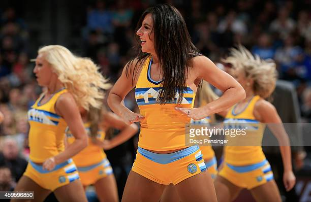 The Denver Nuggets Dancers perform during a break in the action against the Chicago Bulls at Pepsi Center on November 25 2014 in Denver Colorado The...