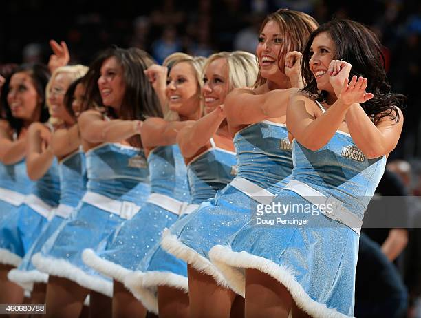 The Denver Nuggets Dancers perform during a break in the action against the Houston Rockets at Pepsi Center on December 17 2014 in Denver Colorado...