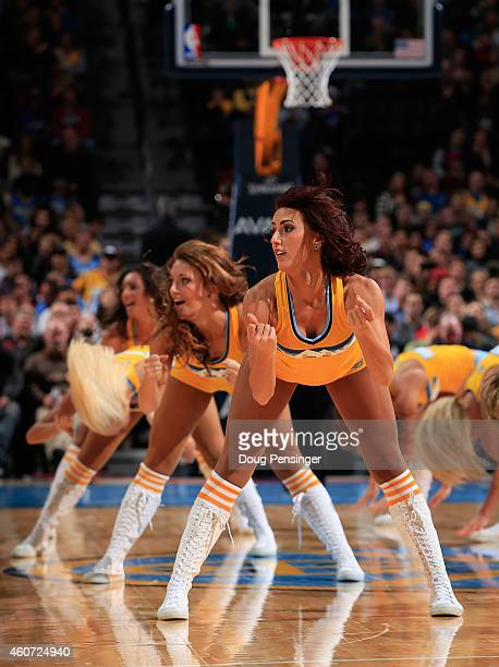 The Denver Nuggets Dancers perform during a break in the action against the Los Angeles Clippers at Pepsi Center on December 19 2014 in Denver...