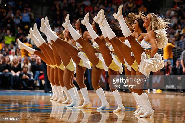 The Denver Nuggets Dancers perform during a break in the action against the Golden State Warriors at Pepsi Center on March 13 2015 in Denver Colorado...