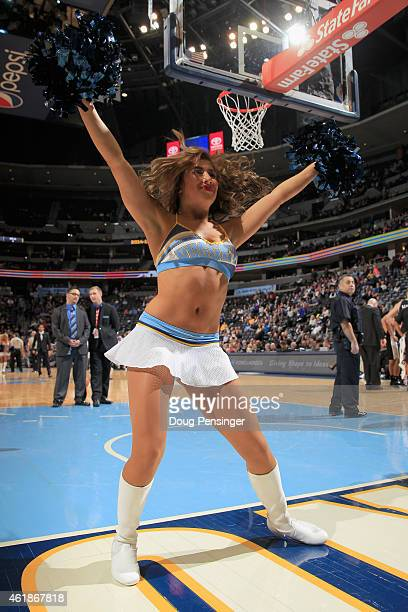 The Denver Nuggets Dancers perorm during a break in the action against the San Antonio Spurs at Pepsi Center on January 20 2015 in Denver Colorado...