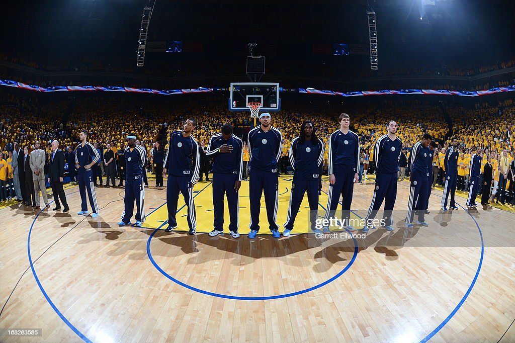 The Denver Nuggets stand during the National Anthem before Game Four of the Western Conference Quarterfinals against the Golden State Warriors during the 2013 NBA Playoffs on April 28, 2013 at the Oracle Arena in Oakland, California.