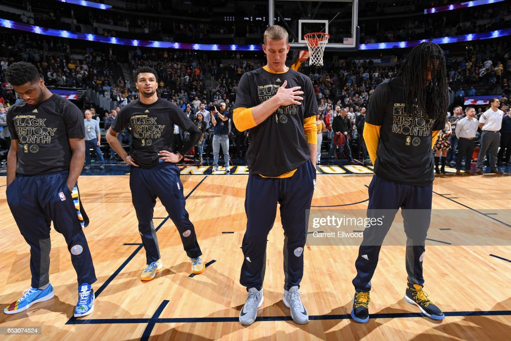 The Denver Nuggets stands for the National Anthem before the game against the Brooklyn Nets on February 24, 2017 at the Pepsi Center in Denver, Colorado.