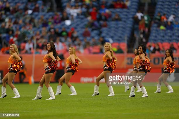 The Denver Outlaws dancers perform during a break in action the against the Chesapeake Bayhawks at Sports Authority Field at Mile High on May 24 2015...