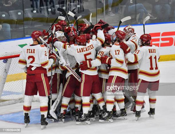 The Denver Pioneers celebrate after defeating the American International Yellow Jackets 30 in the NCAA Division I Men's Ice Hockey West Regional...
