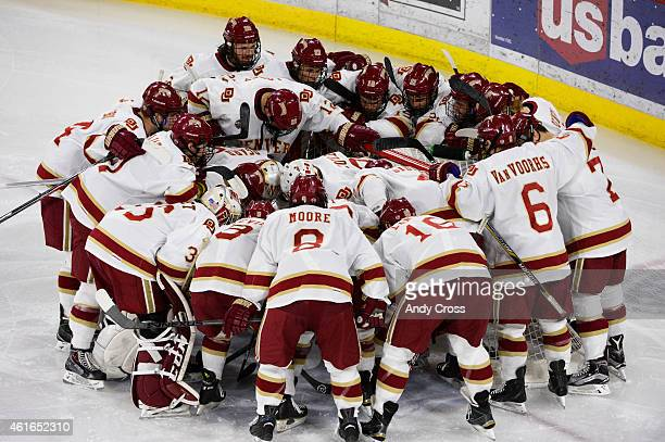 The Denver Pioneers huddle up around their Denver University goaltender Evan Cowley before the game against St Cloud State University at Magness...