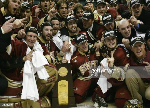 The Denver Pioneers pose with the NCAA National Championship trophy after they defeated the Maine Black Bears during the NCAA Frozen Four...