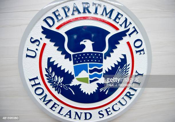 The Department of Homeland Security logo is seen at the new ICE Cyber Crimes Center expanded facilities in Fairfax Virginia July 22 2015 The forensic...