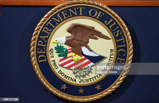 The Department of Justice seal is seen on a lectern ahead of a press conference announcing efforts against computer hacking and extortion at the...