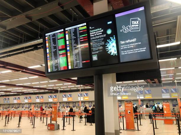 The departure board at an empty Luton Airport terminal on March 17 2020 in Luton United Kingdom Several UK and European carriers are reducing staff...