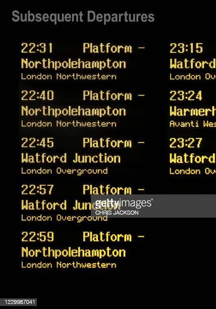 The departure board at London Euston Station shows a destination board for Northpolehampton at London Euston Station in London, England on December...