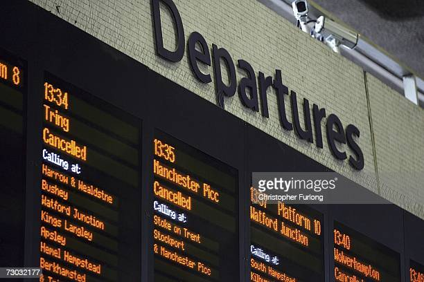 The departure board shows some of the cancelled trains from London Euston train station leaving passengers to sit and wait as mainline services are...