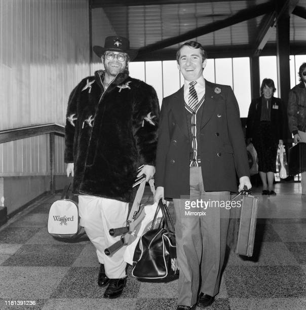 The departure of pop star Elton John from London Heathrow airport to the West Indies Elton John is pictured with his manager John Reid 6th November...