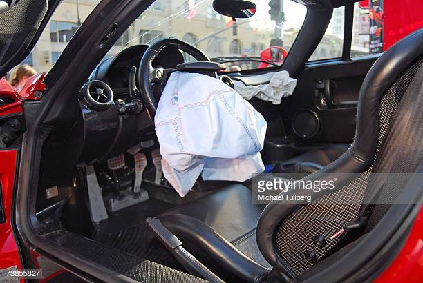 The deployed airbag inside the remains of an Enzo Ferrari previously wrecked by actor Eddie Griffin at a memorial service held for the car in the...