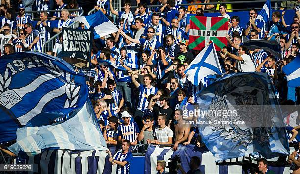 The Deportivo Alaves fans cheer on their team during the La Liga match between Deportivo Alaves and Real Madrid at Mendizorroza stadium on October 29...