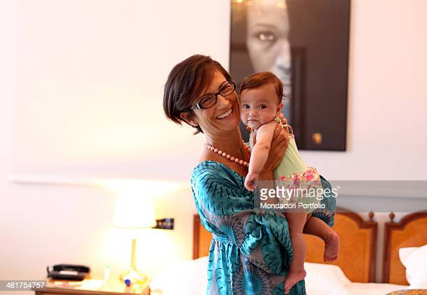 The deputy and Minister of Education Universities and Research Mariastella Gelmini with her daughter Emma during a photo shooting at the Hotel Regina...