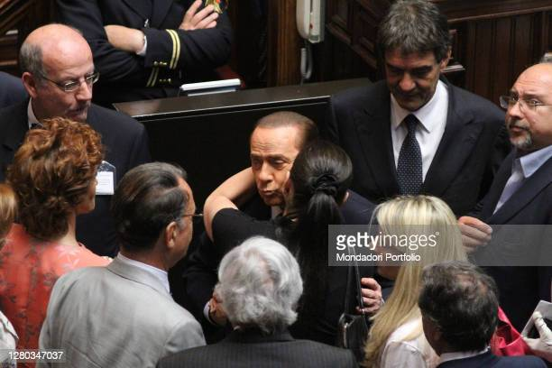 The deputy of the PDL Jole Santelli embraces the Prime Minister Silvio Berlusconi in the Chamber of Deputies during the session for confidence on the...